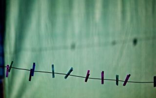 pegs on a line green background
