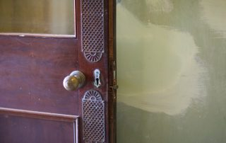 part of brown door with knob